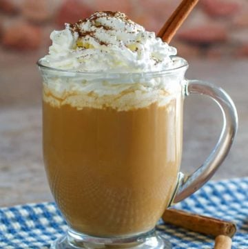 homemade Starbucks pumpkin spice latter in a glass coffee mug