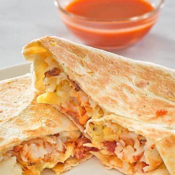 homemade Taco Bell Breakfast Crunchwrap and taco sauce