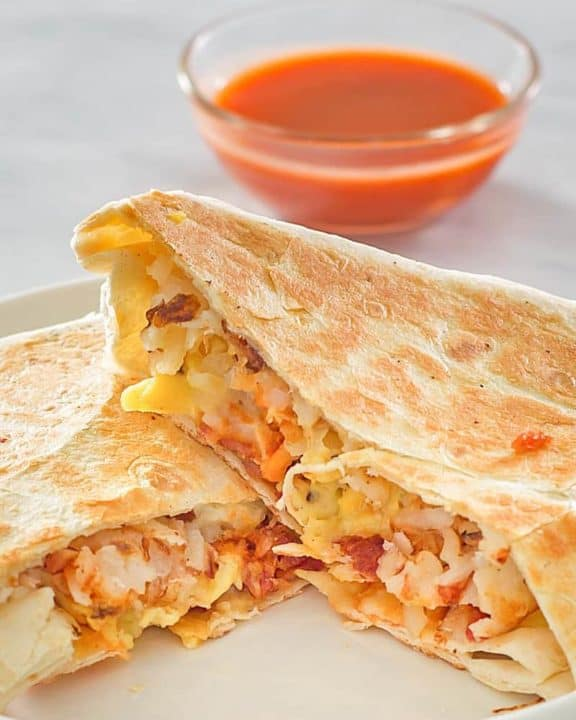 homemade Taco Bell Breakfast Crunchwrap and taco sauce