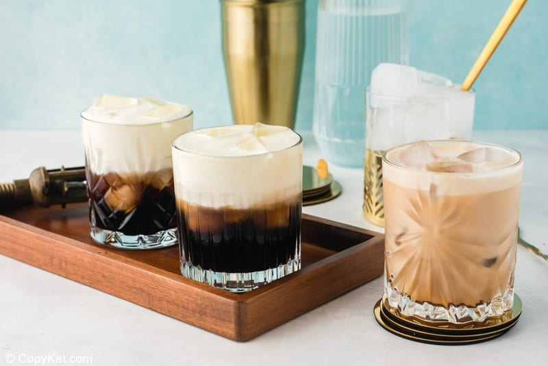 three White Russian cocktails, one stirred