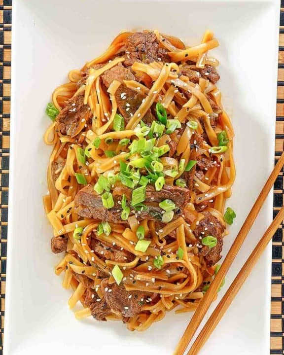 overhead view of beef chow fun on a platter