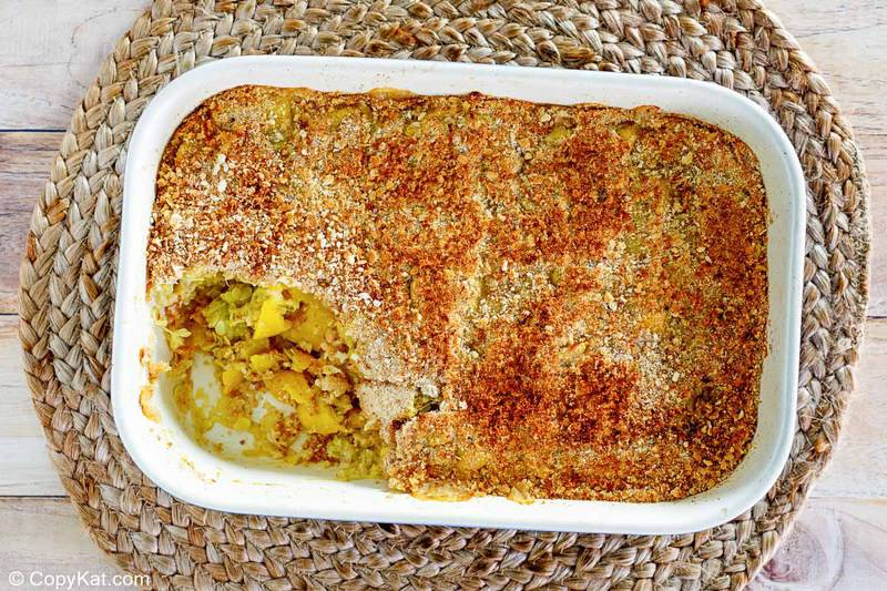 yellow squash casserole in a baking dish