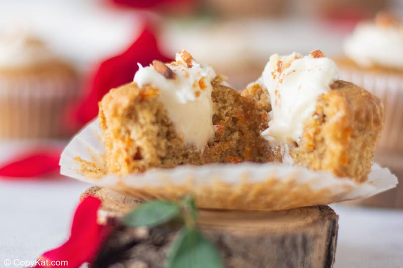 split open carrot cake cupcake with cream cheese filling