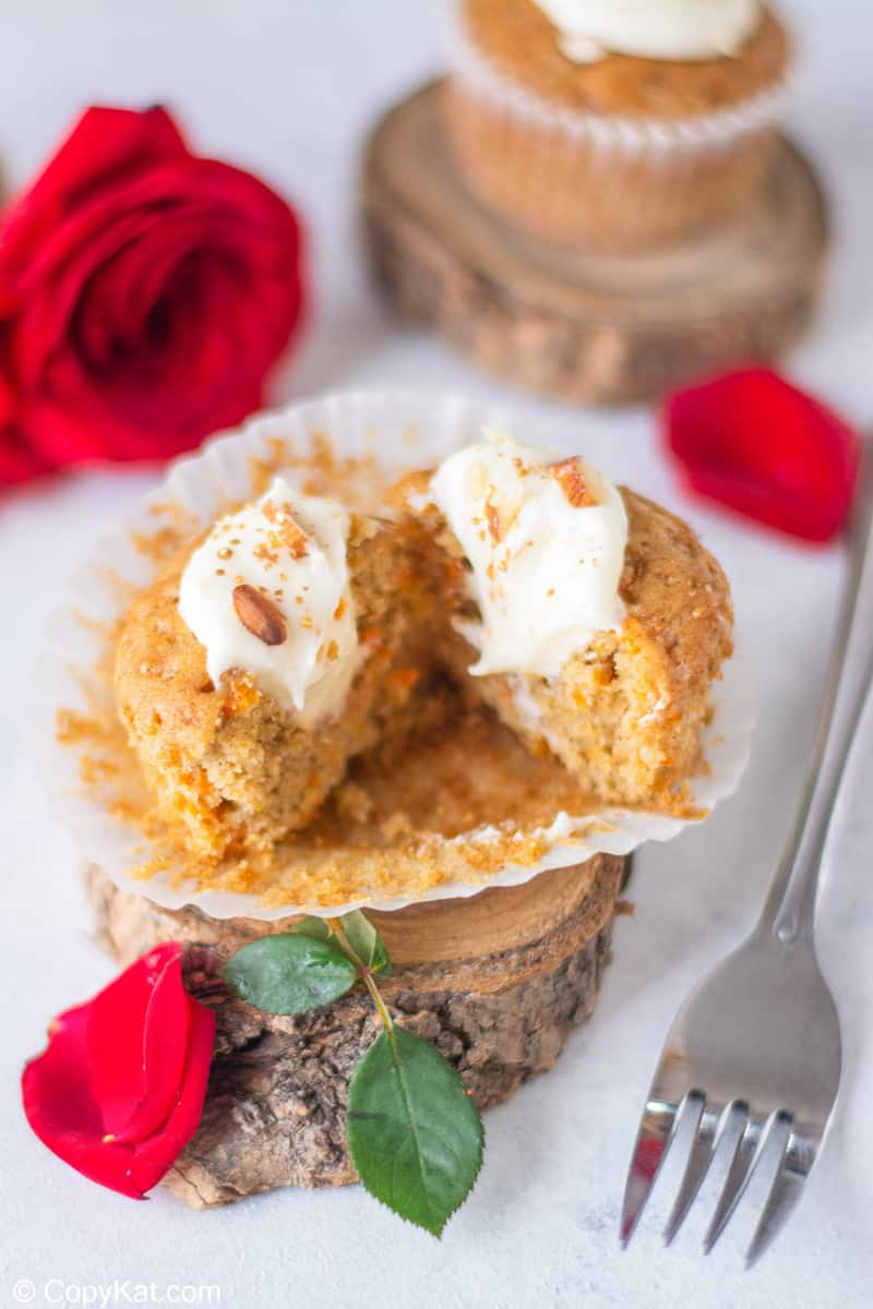 split open carrot cake cupcake with cream cheese frosting