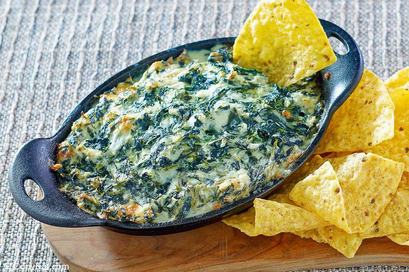 homemade Cheddars Santa Fe spinach dip and tortilla chips on a wood board