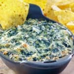 homemade Cheddar's Santa Fe spinach dip in a serving dish and tortilla chips