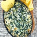 overhead view of homemade Cheddar's Santa Fe spinach dip and tortilla chips