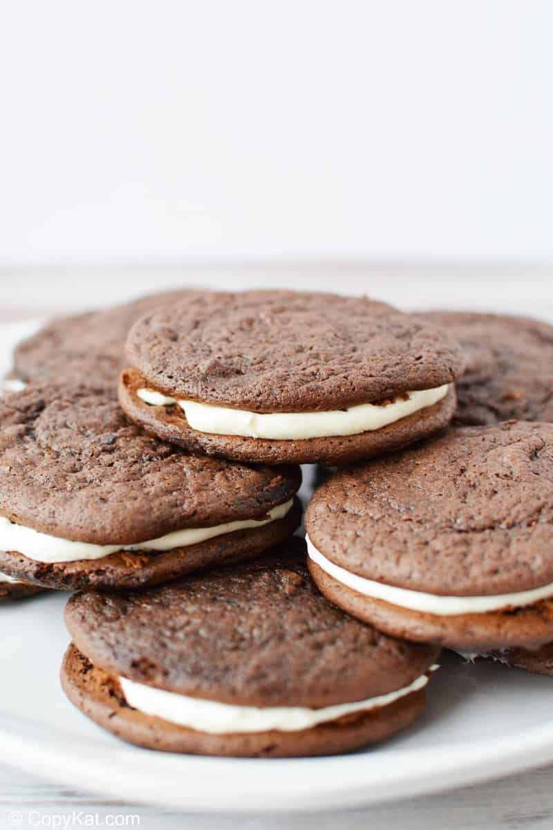 a pile of chocolate sandwich cookies on a plate