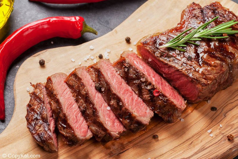 sirloin steak slices on a cutting board
