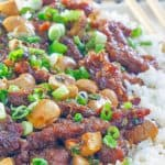 Mongolian beef with mushrooms over rice