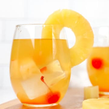 pineapple white wine sangria garnished with fresh pineapple ring