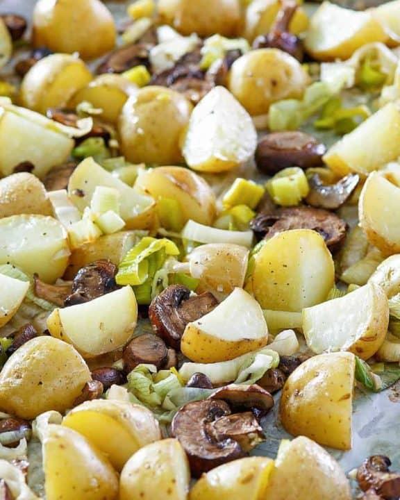 roasted leeks, potatoes, and mushrooms on a sheet pan