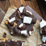 three pieces of rocky road candy with walnuts