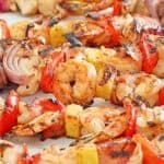 shish kabobs with steak, chicken, shrimp, and vegetables