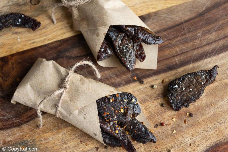 homemade spicy beef jerky wrapped up in parchment paper