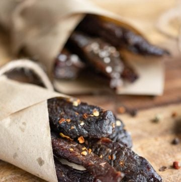 homemade spicy beef jerky wrapped in brown parchment paper