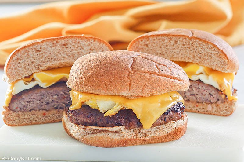 two homemade Whataburger Breakfast on a Bun sandwiches with sausage, egg, and cheese