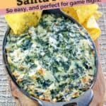 a dish of hot cheesy spinach dip with tortilla chips