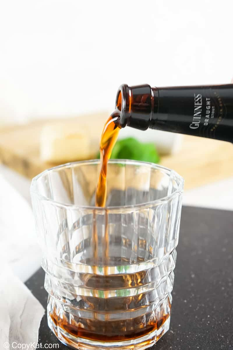 pouring Guinness beer into a glass