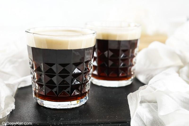two black velvet cocktails on a black marble platter