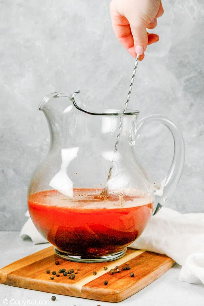 stirring homemade bloody mary mix