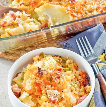 cheesy scalloped potatoes and ham casserole in a baking dish and bowl