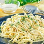 creamy alfredo sauce with fettuccine noodles on a plate