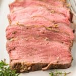 sliced New York strip roast on a platter