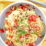 overhead view of copycat Olive Garden Capellini Pomodoro in a bowl