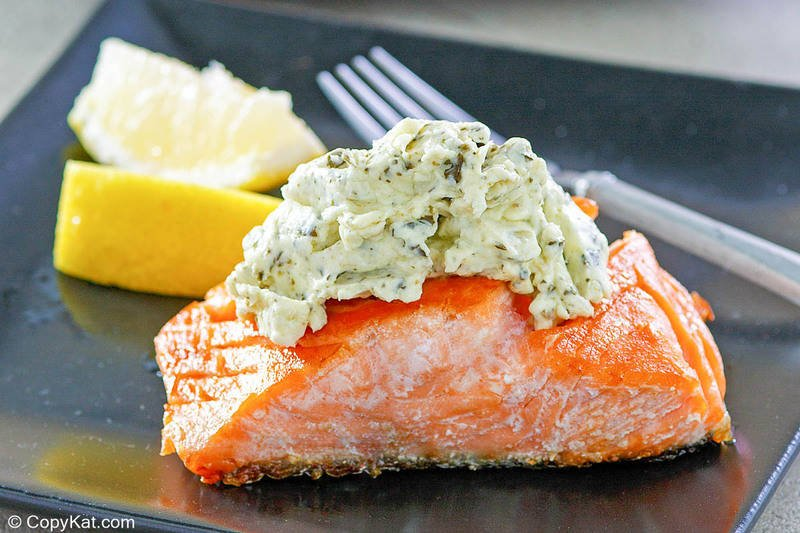 salmon with pesto cream cheese sauce on a plate