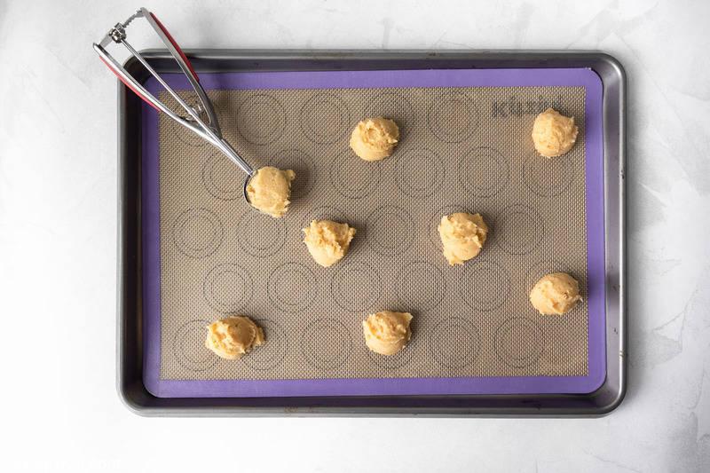 peanut butter cookie dough balls on a baking sheet