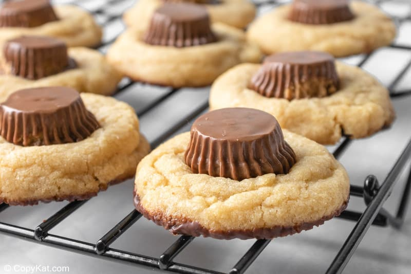 peanut butter cup cookies on a wire rack