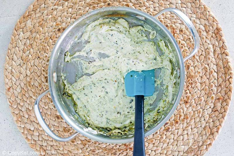 pesto cream cheese sauce in a pan