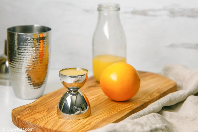 orange juice in a jigger
