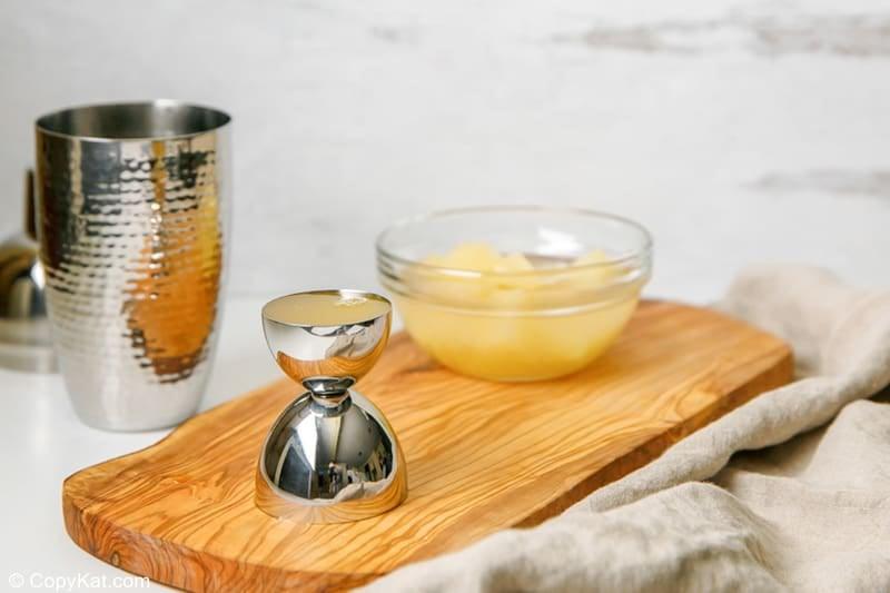 pineapple juice in a jigger