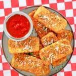 overhead view of homemade TGI Friday's fried mozzarella sticks and marinara sauce