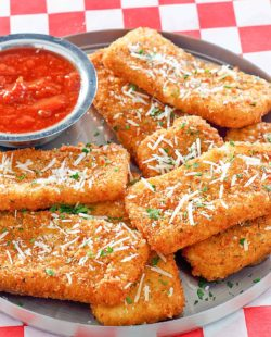 copycat TGI Friday's Fried Mozzarella Sticks and marinara sauce on a platter