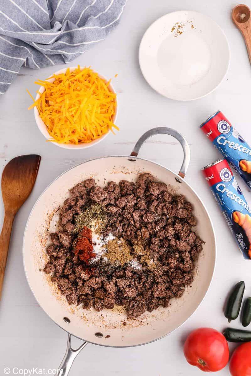 browned ground beef and seasonings in a skillet