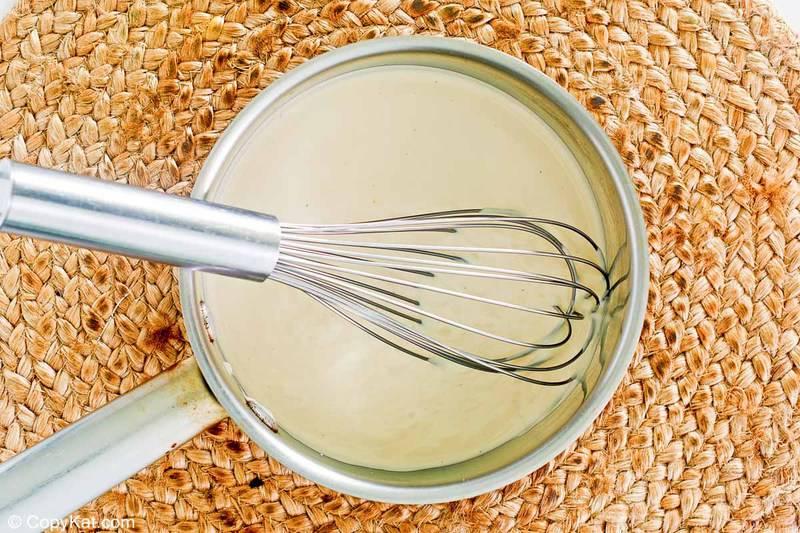 asiago alfredo sauce in a pan