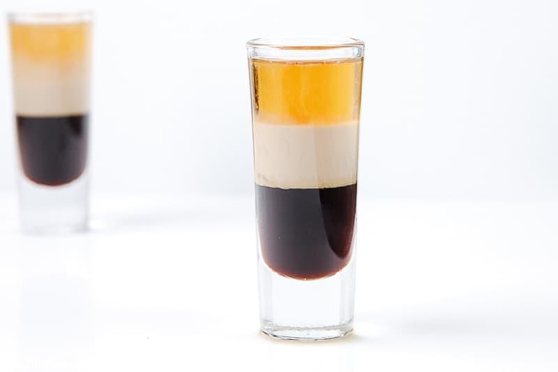 layers of Kahlua, Bailey's Irish Cream, and Grand Marnier in a shot glass