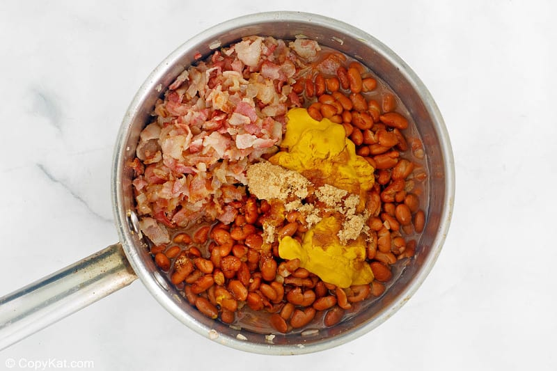 ingredients for BBQ baked beans in a pot