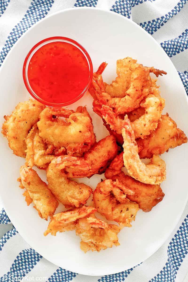 overhead view of beer battered fried shrimp on a platter