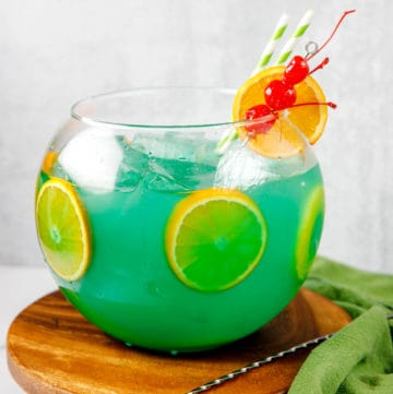 homemade Bennigan's Paddy 'O Punch cocktail on a round wood coaster
