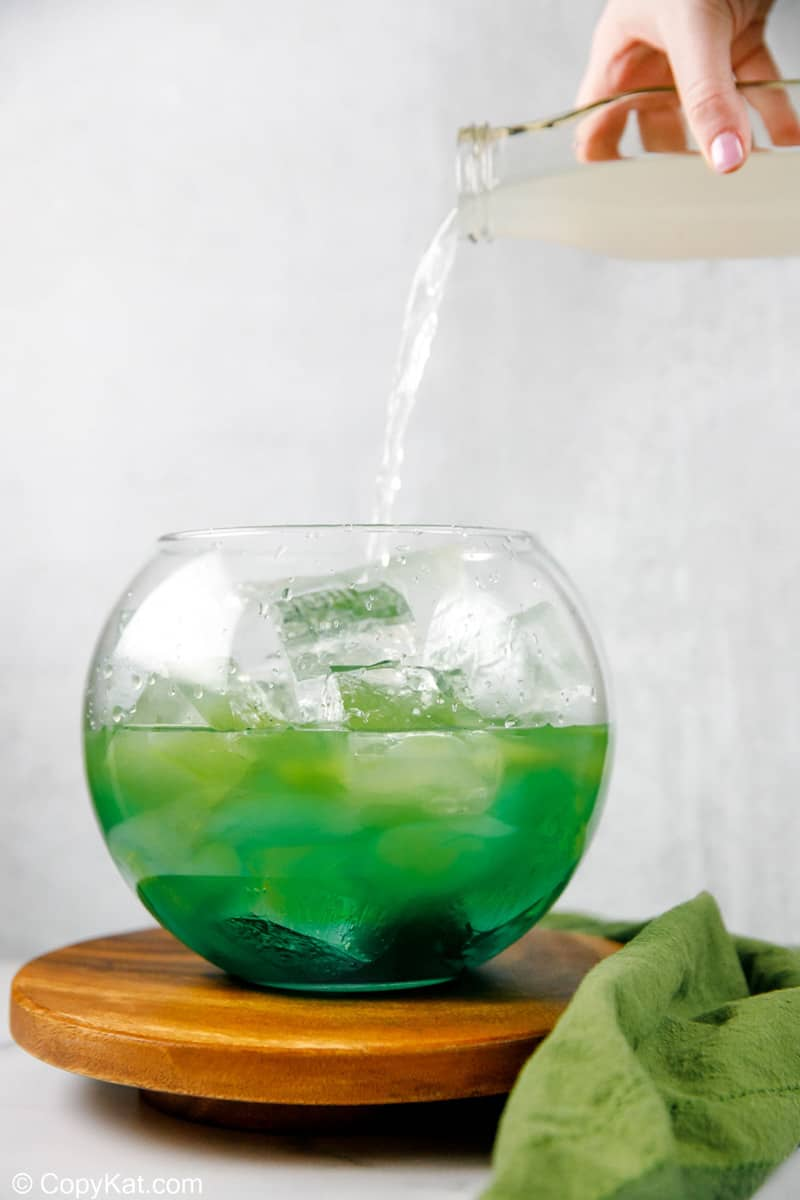 pouring sour mix into a glass