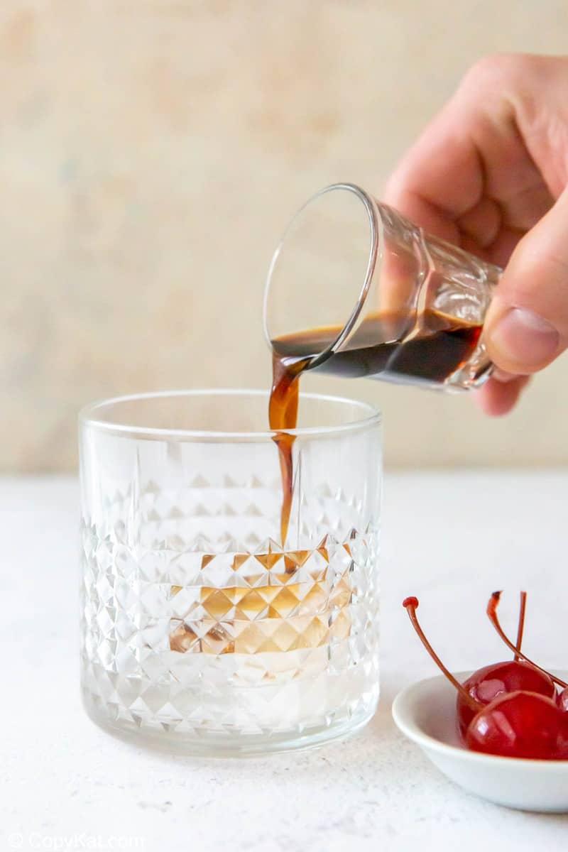 pouring Kahlua into a glass