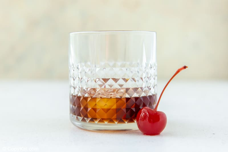 Black Russian cocktail and a cherry