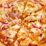 homemade CPK BBQ chicken pizza on a pizza peel