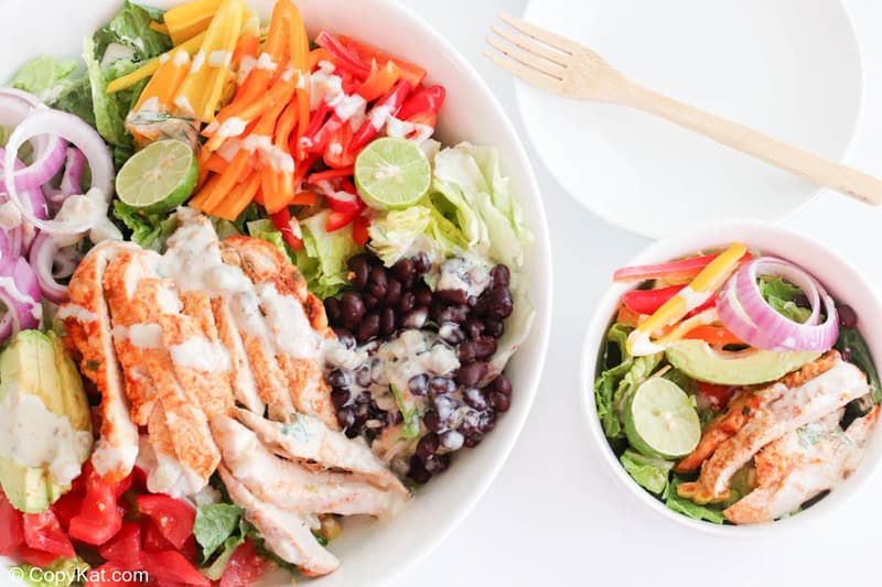 chicken fajita salad in large and small bowls