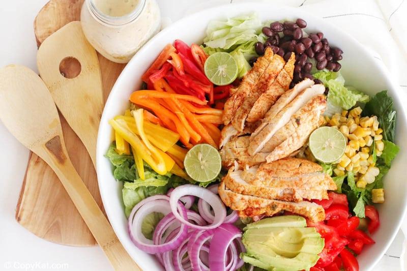 chicken fajita salad, creamy salsa verde dressing, and wood salad servers