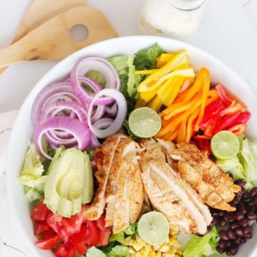 overhead view of chicken fajita salad and creamy salsa verde dressing